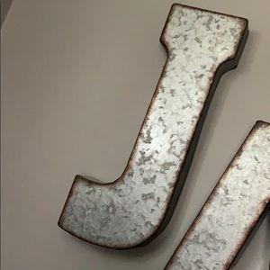 Large metal J
